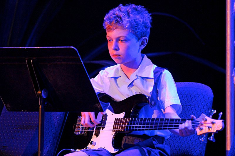 A King's kid playing electric guitar